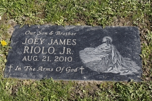 Riolo black cemetery marker with etching.jpg