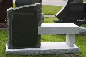 black - rock border and bench - grave stone