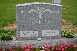 Barry-gravestone-with-core-holes-for-planting